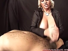 Big Tit Domina Gives A Suppliant A Handjob