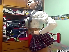 Big Bristols &amp_ ass Latin schoolgirl striptease out of her uniform