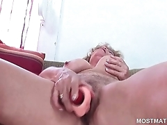 Mature blonde teasing pussy with vibrator