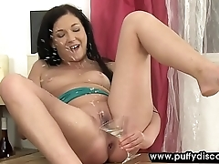 Raven haired babe snacks and plays with her pee