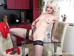 Down in the mouth blonde in stockings pleases herself with dildo