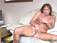 Elderly gripe undresses and fingers her mature twat