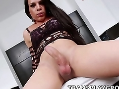 Curvy latina tranny Ariane de Briho plays with her big dick