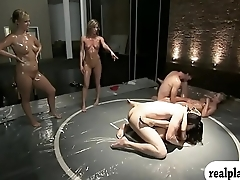 Two erotic women with nice boobs oil wrestling with dudes