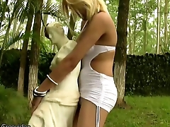 Tempting blonde shemale strips off in public and masturbates