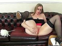 British milf Sammie pushes a butt plug up her ass